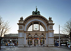 The grand old entrance to Lucerne station stands in front of the modern railway building