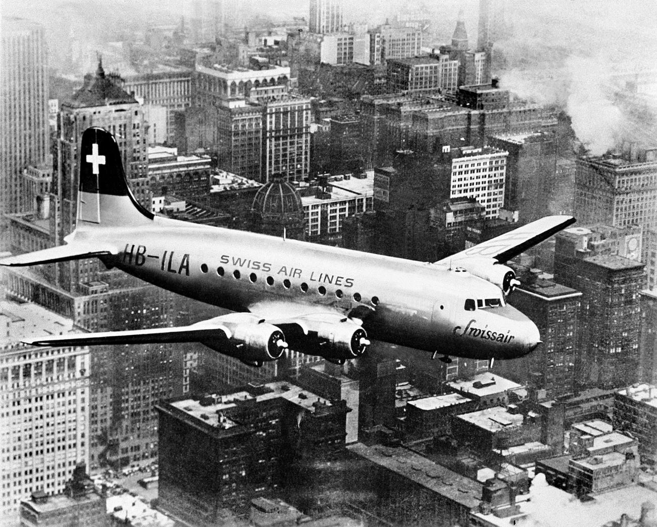 A DC-4 Swissair plane on a non-stop flight from New York to Geneva.