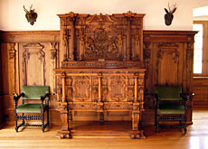 Carved sideboard in the oak-panelled Landshut Room at 17th-century Castle Landshut in canton Bern