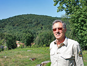 Behind Romano Barzaghi is a forested slope that was once planted with potatoes