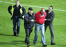 A hooligan is expelled during a match between Aarau and Lucerne