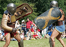 Gladiators re-enact a battle at the site's annual Roman festival