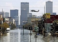 A military helicopter searches for flood survivors in New Orleans