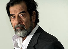 Former Iraqi leader Saddam Hussein during pre-trial investigation