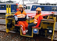 A girl accompanies her father to work on the railways in 2004