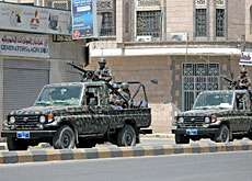Yemeni security forces patrol a street of the capital, Sana'a