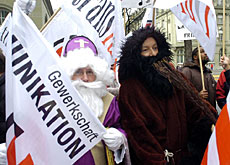 Swisscom employees, dressed up as Santa and his helper, take to the streets