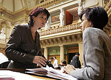 Christian Democrats party leader Doris Leuthard (left) talks to her parliamentary colleague Ruth Humbel