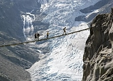 A bridge has been built where hikers could once walk over the tongue of the receding Trift glacier