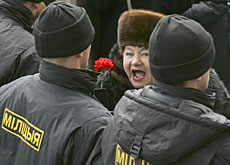 A Belarussian shouting anti-Lukashenko slogans in front of riot police at the weekend