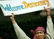 A demonstrator protests outside the Myanmar embassy in Tokyo