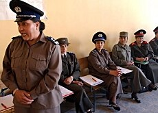 A female police officer speaks during a recruitment workshop in Kabul
