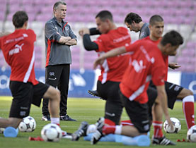 New coach of Switzerland Ottmar Hitzfeld eying his charges ahead of a friendly against Cyprus