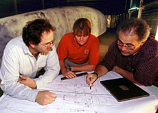 Swiss engineers studying plans of the Swiss team's America's Cup training boat