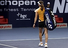 Down and out: Martina Hingis leaves the court after her quarterfinal defeat to Swetlena Kusnezowa