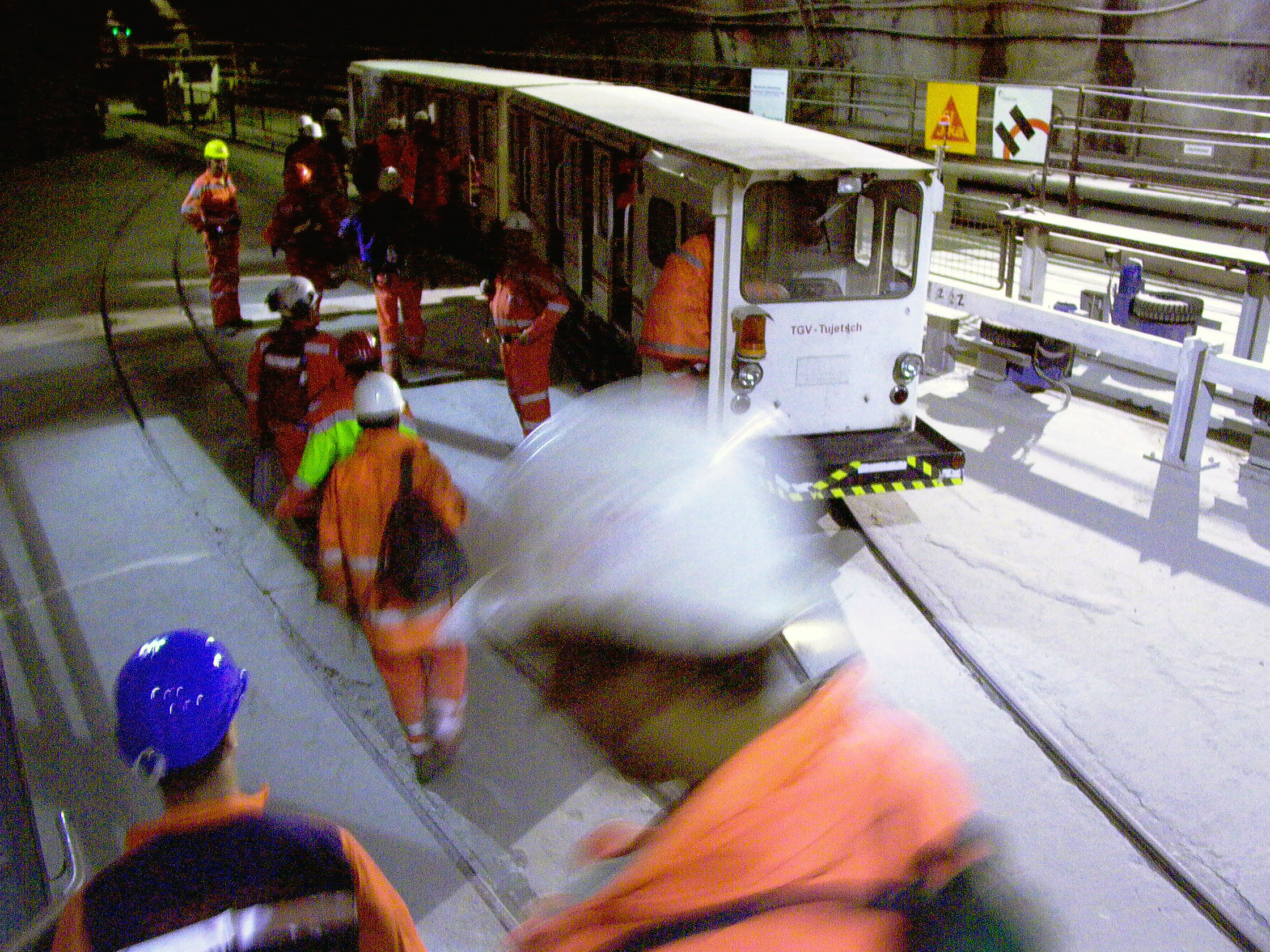 "Changing from the lift into a little train, which the workers have affectionately christened ""TGV Tujetsch""."
