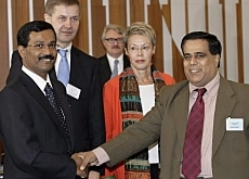 S. P. Thamilselvan, left, of the Tamil Tigers shakes hands with Nimal Siripala De Silva, right, of the Sri Lanka government