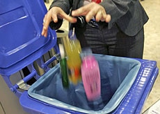 Confiscated items head into a bin at Geneva airport on Monday