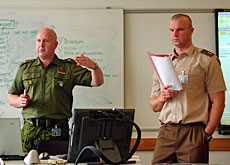 Army officers role-playing in a Swiss-run PfP training course