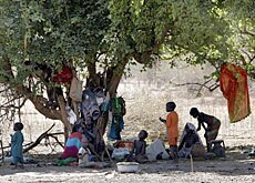 A family forced to leave their home as a result of ethnic violence in Darfur