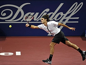 Is the writing on the wall for tobacco sponsors? Here, Roger Federer stretches at last year's Davidoff Swiss Indoors
