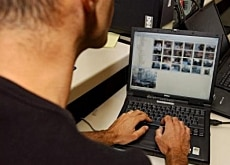 A police officer in Geneva surfs the web for illegal sites