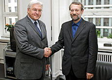 Ali Larijani (right) also met the German foreign minister during his trip to Europe