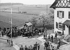 Refugees waiting to cross the Swiss border near Schaffhausen in 1945