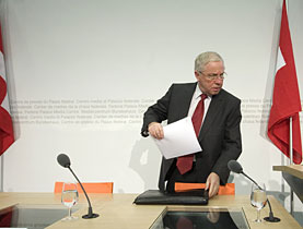 Outgoing Justice Minister Christoph Blocher packs his things after Friday's media conference