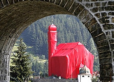 The church at Wassen, a landmark on the Gotthard line, is draped in red for the 125th anniversary celebrations