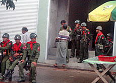 Soldiers guard the site of the protests last month in Myanmar