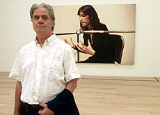 Franz Gertsch in front of his portrait of US musician Patti Smith