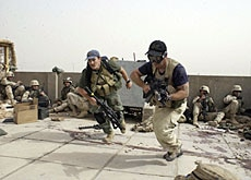 Blackwater employees and US soldiers during a firefight in Iraq in 2004
