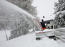Clearing some of the 30cm of snow that fell in Davos on Saturday night