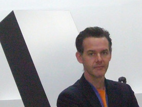 "Wahler in front of ""Cathedral Evening"" by Ronald Bladen and Nancy Grossman's leather heads at the Palais de Tokyo in Paris"