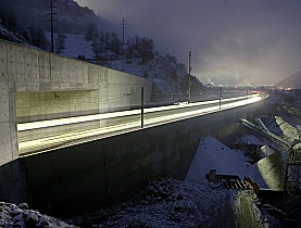 One of the first passenger trains passes the tunnel near Visp in southwestern Switzerland