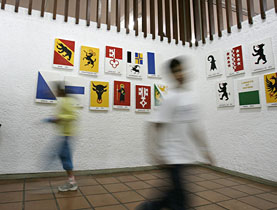 Students walk pass the Swiss cantonal flags in Sao Paulo's Swiss school