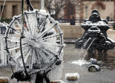 A fountain by Jean Tinguely frozen by winter temperatures in Basel