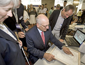 Swiss President Pascal Couchepin (centre) tries out a tactile map for the blind developed by Geneva engineering students