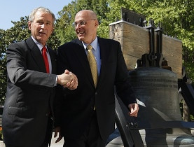 President Bush and Henry Paulson welcome the passing of the bank rescue plan