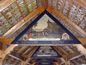 Some paintings still grace the interior of Lucerne's covered Chapel Bridge