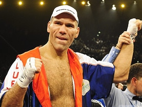 Valuev celebrates after his victory against Holyfield in Zurich