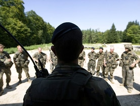 All able-bodied Swiss males between the ages of 20 and 36 must serve 260 days of military service