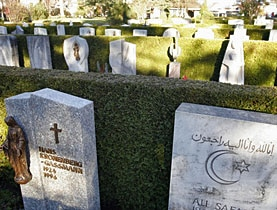 Christian and Muslim gravestones next to each other in a Swiss cemetery