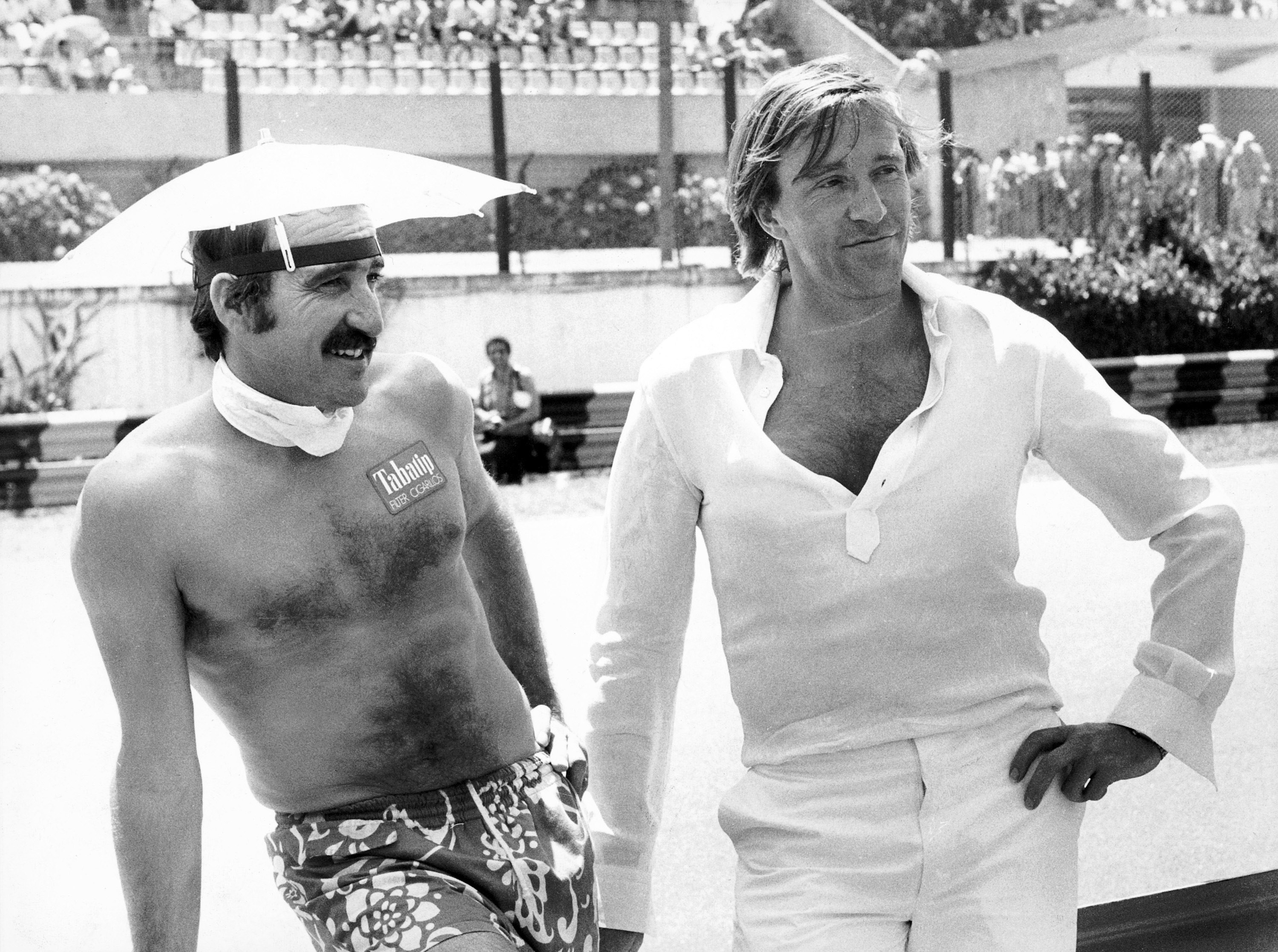 Clay Regazzoni and German football player Günter Netzer, Argentinian Grand Prix, 1978 (RDB)