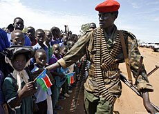 A member of Sudan's Liberation Movement cordons off the crowd during the visit of UN Secretary-General Ban Ki-moon