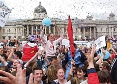 Confetti comes down on the jubilant crowds in London's Trafalgar Square