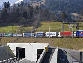 The Swiss way through the Alps: trucks piggy back on a train