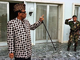 Mobutu Sese Seko greets a soldier outside his residence in the then-Zairian capital Kinshasa in April 1997