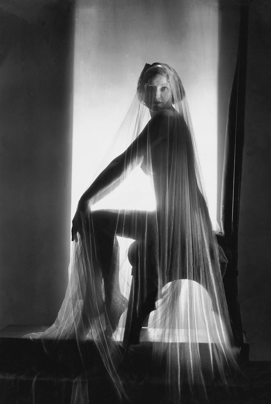 Photographic study, a naked woman covered with a see-through with veil.